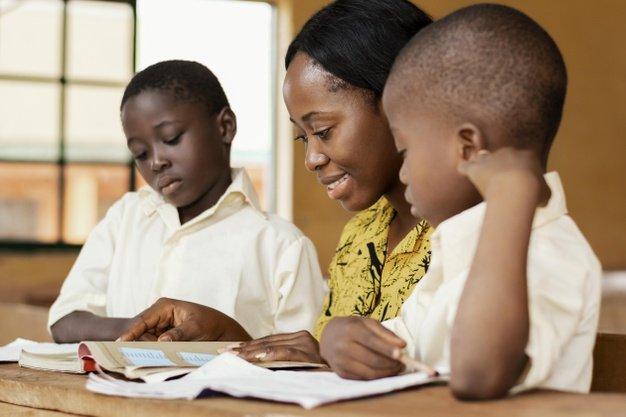 teacher-helping-kids-class_23-2148892532